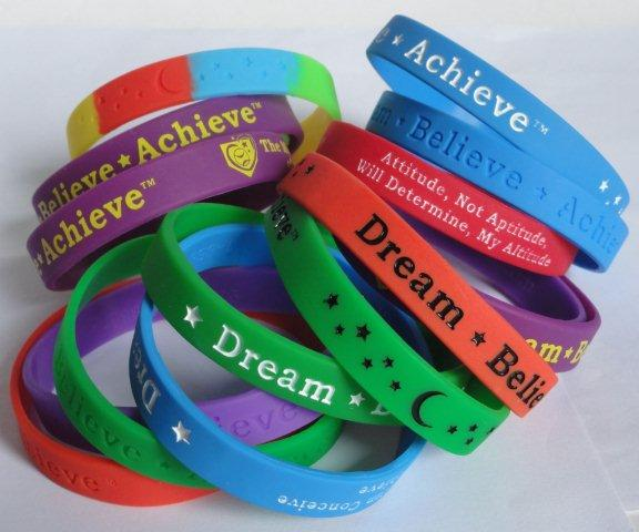 Dream-Believe-Achieve™ motivational wristbands with inspiring words and philosophies come in different colors including custom wristbands
